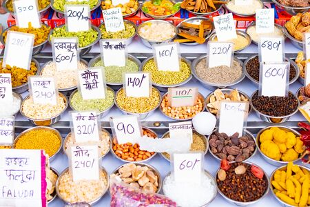 NEW DELHI, INDIA, MAR 30 2019 - Indian small shops with colorful spices and herbs on traditional spicy market Redakční