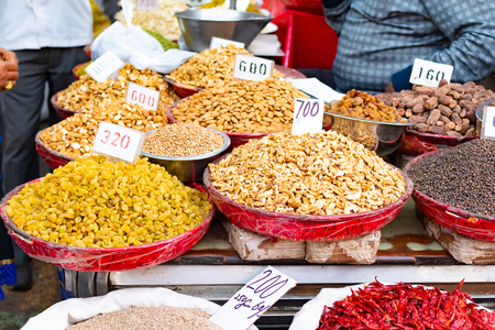 Traditional spices, dry fruits and nuts in local spicy bazaar in New Delhi, India