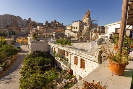 GOREME, TURKEY: Old rocks that serve as houses and hotels for tourists. Goreme is town in Cappadocia, Nevsehir Province, Central Anatolia, Turkey