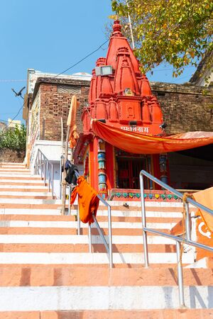 VARANASI, INDIA, MAR 10 2019 - Small Shiva temple on Embankments of the Ganges, Varanasi, India