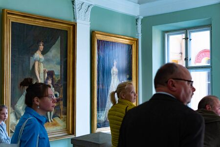 Radun, Czech Republic, 7 April 2019 - The interior with beautiful pictures on wall and tourists of Radun Castle, located near Opava Redakční