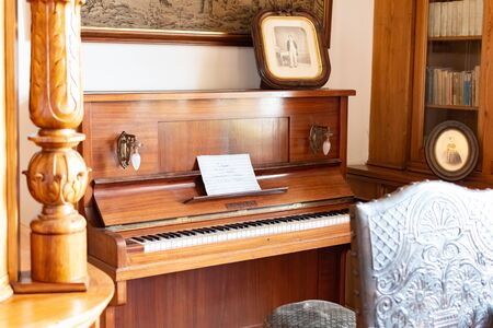 Radun Castle, Czech Republic, 7 April 2019 - Old wooden piano in piano room in castle style Redakční