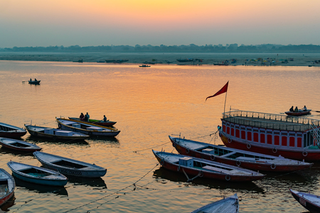 Sunrise at Ganga River with people ride a boats, Varanasi, India
