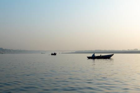 Varanasi, India, 27 Mar 2019 - Dashaswamedh Ganges river ghat Varanasi at twilight with tourists enjoying boating rides