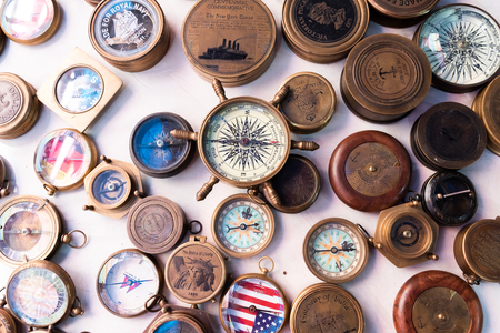 Beautiful and colorful vintage compasses, travel background