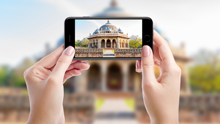 Taking a photo with mobil phone of Humayuns tomb, Top sights of New Delhi, India