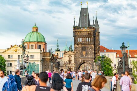 Prague, Czech Republic, 20 June 2019 - Famous Charles Bridge in Prague with people crowd before storm