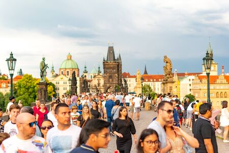 Prague, Czech Republic, 20 June 2019 - Famous Charles Bridge in Prague with people crowd before storm Reklamní fotografie - 127884768
