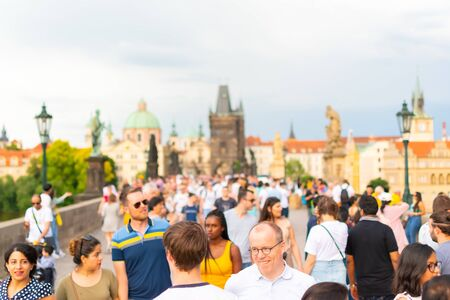Prague, Czech Republic, 20 June 2019 - Famous Charles Bridge in Prague with people crowd before storm Reklamní fotografie - 127884771