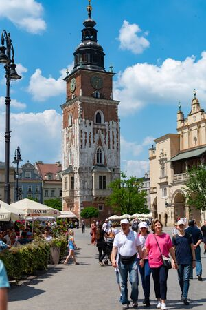 Krakow, Poland, 10 May 2019 - Tourists on main Square Old Town Square of Krakow, Poland Reklamní fotografie - 127884783