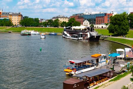 Krakow, Poland, 10 May 2019 - Picturesque landscape on coast river Wisla with boats, Krakow, Poland