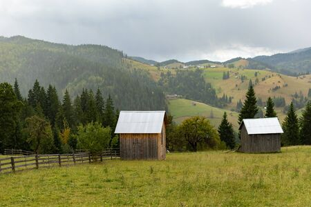 Beautiful landscape mountain hill meadow sunrise morning Bucovina village Romania. Reklamní fotografie