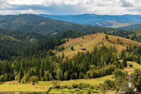 Beautiful landscape mountain hill meadow sunrise morning Bucovina village Romania Reklamní fotografie - 132653366