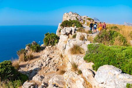 MALLORCA, SPAIN - July 8, 2019: Mirador es Colomer - tourists visit the main viewpoint at Cap de Formentor located on over 200 m high rock. Mallorca, Spain. Redakční