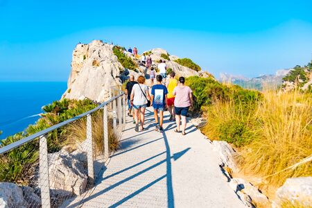 MALLORCA, SPAIN - July 8, 2019: Mirador es Colomer - tourists visit the main viewpoint at Cap de Formentor located on over 200 m high rock. Mallorca, Spain