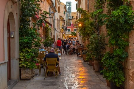 Night or blue hour view of a narrow street in the old town of Alcudia, Mallorca, Spain