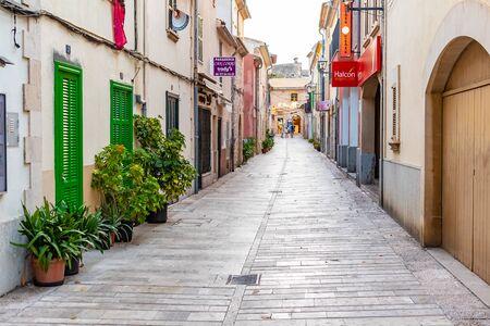 Beautiful narrow historic streets of Alcudia Old Town in Majorca Mallorca