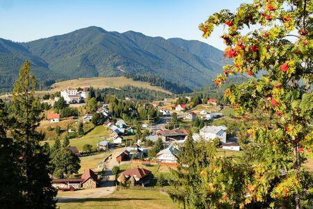 Beautiful fairytale landscape of Tihuta pass Village in North Romania during sunny autumn day
