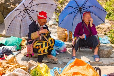 Sapa, Vietnam, 15 March 2018 - The Yao Ethnic tribe selling products to tourists, herb, product of locally with woman, Sapa, Vietnam