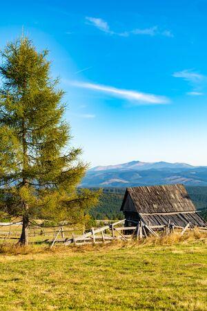 Autumn rustic landscape with old hut, sunny autumn day, in Carpathian mountains, Romania. 版權商用圖片