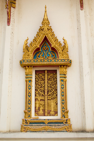 asian art: window of buddha church in front view.Phichit Province, Thailand
