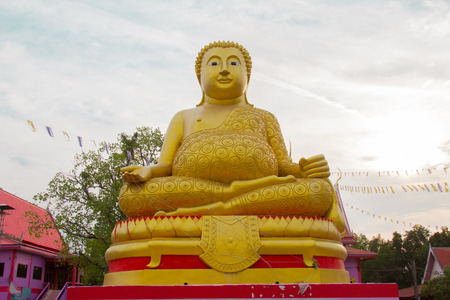 god walking: March 27, 2017 : Big Golden Buddha statue over scenic white and blue sky at Wat Sai Dong Yang Temple. Phichit, Thailand.