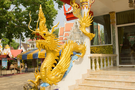 asian art: Beautiful gold dragon statue at Wat Mai Kham Wan temple, Phichit, Thailand.