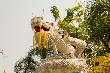 asian art: Beautiful white dragon statue at Wat Mai Kham Wan temple, Phichit, Thailand. Stock Photo