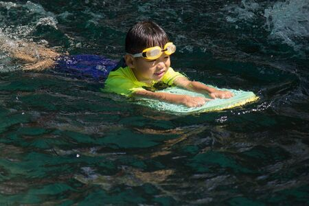 Boy Swimming. Activities on the pool, children swimming and playing in water, happiness and holiday.