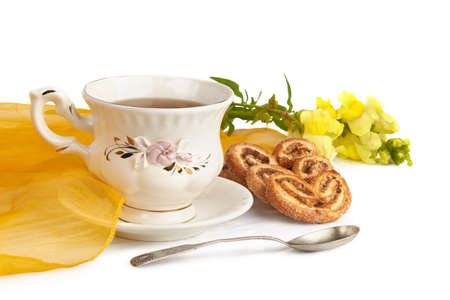 Tea Time  Cup of tea with cookies, studio isolated  Stock Photo - 14398450