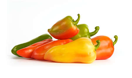 Heap of fresh bell peppers on white background.