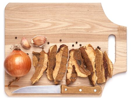 Dried Cepes  Ingredients for cooking mushroom dish on wood board  Stock Photo