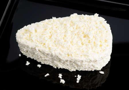 Fresh cottage cheese on black salver  Stock Photo