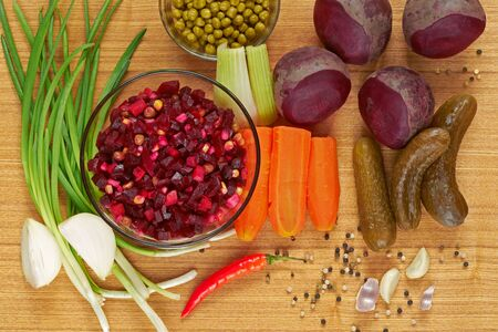 Beetroot salad, known as Vinaigrette. Ingredients: beetroots, carrots, green peas, spring onion, pickles and etc. Stock Photo