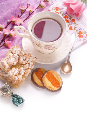 Good morning with cup of tea and pastry. Sweet dessert for breakfast. Flowers. Lifestyle.