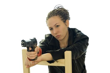 Girl in black jacket with a gun photo