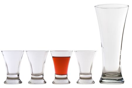 full shot: three empty shots, one empty beer glass and one full shot Stock Photo