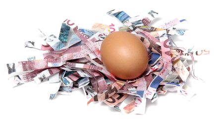 shredded european currency with egg Stock Photo