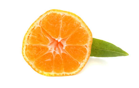 truncated mandarin orange with green leave photo