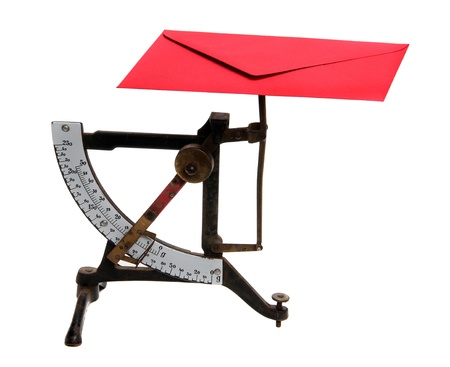 ascertain: letter scales with red envelope Stock Photo