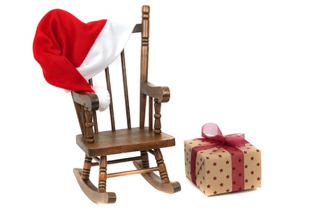 endow: old wooden rocking Chair with red jelly bag cap Stock Photo
