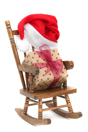 endow: old wooden rocking Chair with red jelly bag cap and christmas present