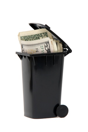 several bank notes in black rubbish bin on white photo