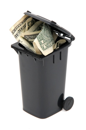 dollar notes in black rubbish bin on white photo