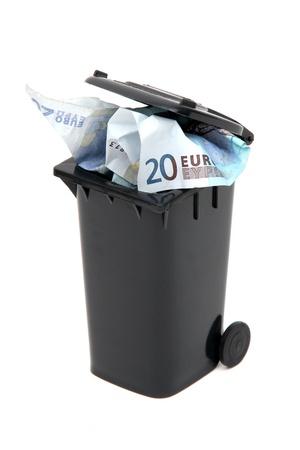 european bank notes in black rubbish bin on white