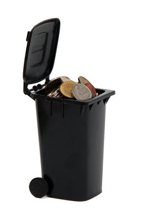 garbage bin filled with old european coins on white