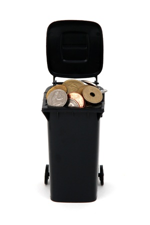 rubbish bin with old european coins on white photo