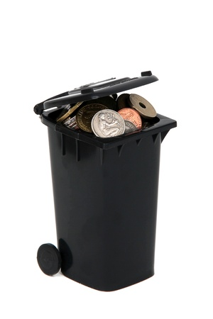 black rubbish bin with european coins on white photo