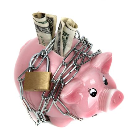 pink piggy bank with chain and padlock Stock Photo