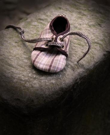 Loneliness -shoe on stone photo